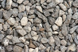 small road stone background, dark gravel pebbles stone texture. Closeup top view gravel. Gravel in garden. Pattern.