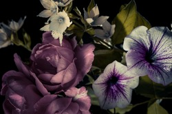 small roses and garden flowers, abstract bouquet on a dark background.