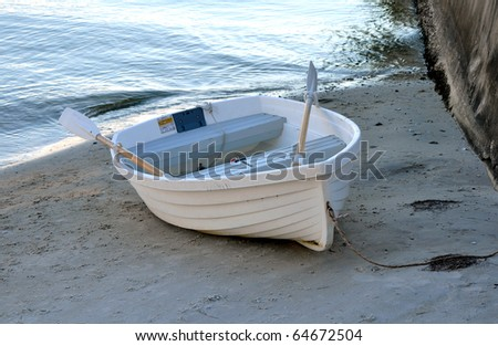 Small rowboat anchored at shore, in St. Petersburg, Florida
