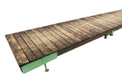 Small rural wooden bridge - planked foot way. Isolated with patch. Selective focus