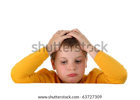 Small sad and hopeless boy holding his head with both hands resting arms on blank whiteboard isolated on white