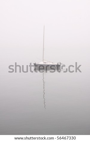 Small sailing boat in a river in a misty morning #56467330
