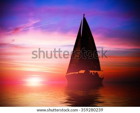 Small sailing yacht floating on horizon line