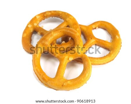 small salted pretzels on a white background