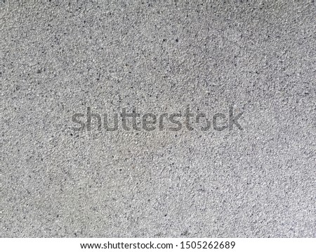 Small sand stone in light grey color. Grey texture. Grey floor.