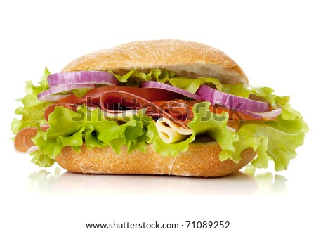 Small sandwich with ham, cheese, tomatoes, red onion and lettuce. Isolated on white