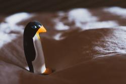 Small sculpture of acute  penguin