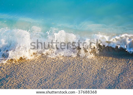Small sea waves ending in the sand