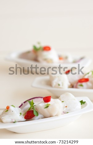 Small seafood dish with raw cod marinated in lime juice