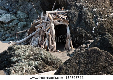 Small shack made from drift wood on the beach