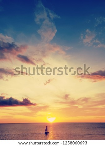 small ship on beautiful sunset,abstract meaning of brave in your own,belive in you self,Self esteem concept,vintage tone.