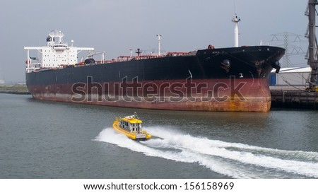 Small ship passing a big ship
