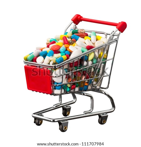 Small shopping cart full of pills isolated on white
