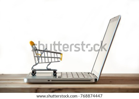 1c851063fe5 Small Shopping Cart On Laptop With Copyspace   Online Shopping Concept.  E-commerce.