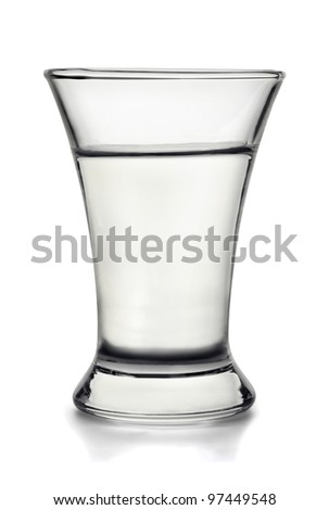 Small shot glass filled with  alcohol isolated on white