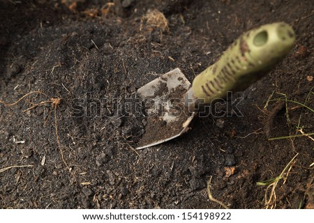 small shovel stuck in the soil