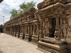Small shrines with lion sculptures in the row of pillars in ancient Kanchi Kailasanathar temple in Kanchipuram, Tamil nadu