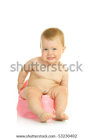 Small smiling baby on pink chamber-pot - stock photo