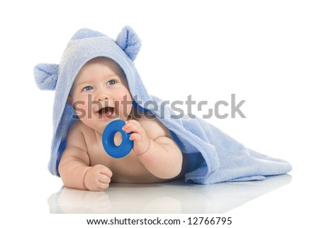 Small smiling baby with a towel isolated - stock photo