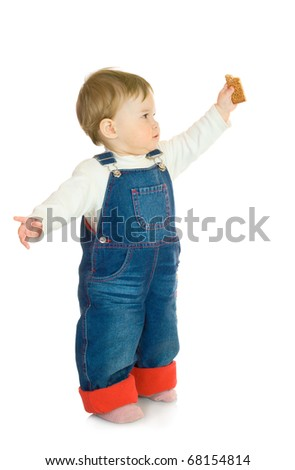 Small smiling baby with cookie - stock photo