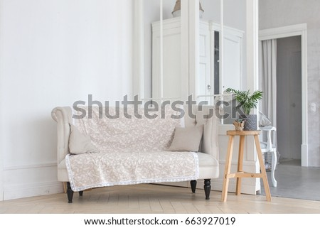 Small sofa in room
