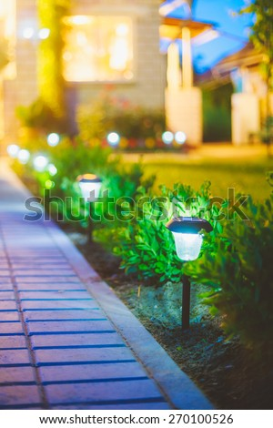 Small Solar Garden Light, Lanterns In Flower Bed. Garden Design. Solar Powered Lamp #270100526
