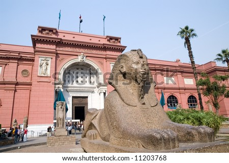 Small sphinx statue and The Egyptian Museum in Cairo, Egypt