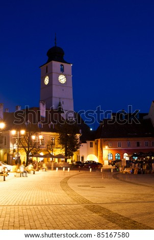 Small square and council tower in sibiu, romania, at night