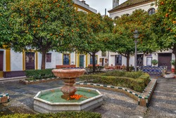 Small square with a fountain in the historic center of Seville, Spain