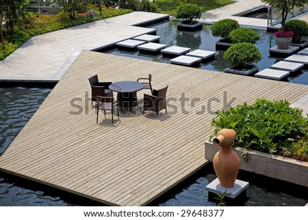 Small square  with chairs and table view from the top in residential district