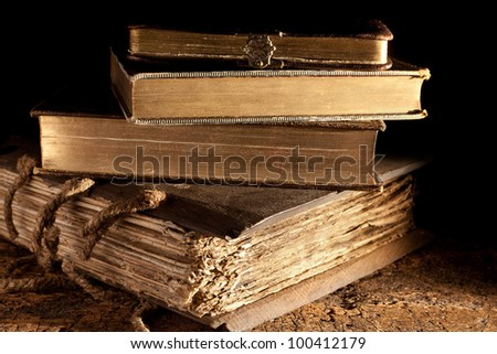 Small stack of antique books in weathered grungy state and gold edged
