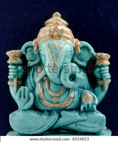small statue of Ganesha, a hindu symbol