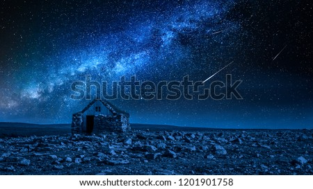 Small stone cottage and milky way with falling stars, Iceland #1201901758
