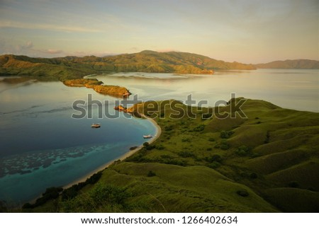 Small strait between two unmanned island  view from hill, in the beach there are two boat for sailing trip, the favorite choice for adventure trip in the archipelago #1266402634