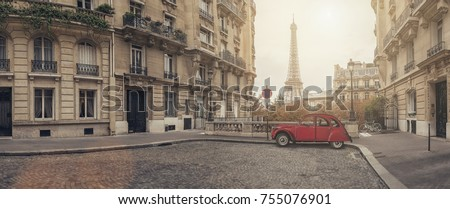 small street in paris with view on the famous Eiffel tower - panorama