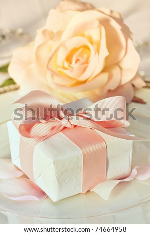 stock photo Small thank you gift on plate at wedding reception