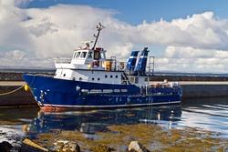 Small tourist ferry in Irish harbor