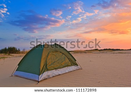 small touristic tent in a desert at the evening