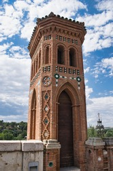 Small tower with mudejar style architecture door at the top of the oval staircase in Teruel, Spain