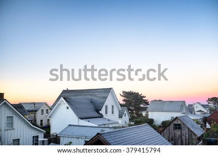 Small town America view of rooftops in early morning light. Copy space #379415794