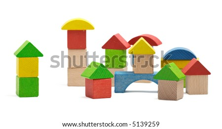 Small town build from wooden blocks isolated on white background