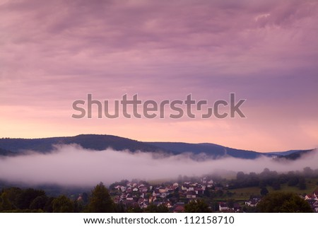 small town in Bavarian mountains at sunrise