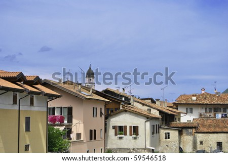 small town with a bell tower and residential buildings with blue sky