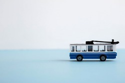 small toy blue and white trolley, place for text