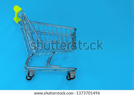 Small toy pushcart on a blue background