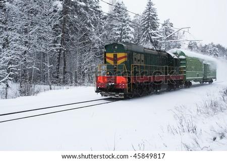 Small train moving in winter