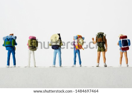 Small traveller figure for World Tourism Day background - September 27, UNWTO World Tourism Day celebration concept #1484697464