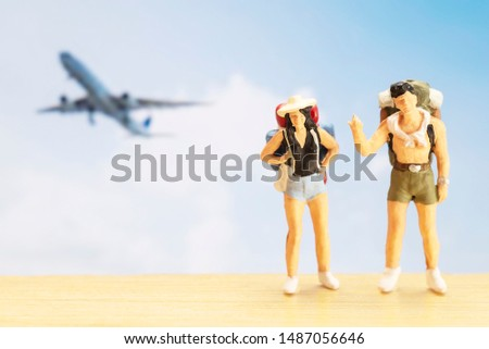 Small traveller figure for World Tourism Day background - September 27, UNWTO World Tourism Day celebration concept #1487056646