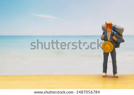 Small traveller figure for World Tourism Day background - September 27, UNWTO World Tourism Day celebration concept #1487056784