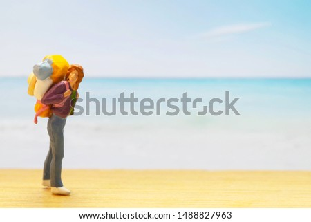 Small traveller figure for World Tourism Day background - September 27, UNWTO World Tourism Day celebration concept #1488827963